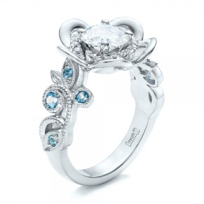 1.00 Diamond Center Gem - 14k White Gold Ring 8 Blue Topaz - .15 ctw 18 Diamonds - .12 ctw Clarity: VS2 - Color: F-G Joseph Jewelry - 3Qtr View