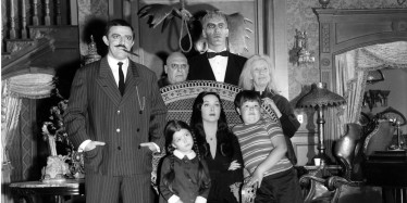 """UNITED STATES - SEPTEMBER 18: THE ADDAMS FAMILY - Pilot - Season One - 9/18/64, """"The Addams Family"""" was based on the characters in Charles Addams' """"New Yorker"""" cartoons. The wealthy Gomez Addams (John Astin, left) was madly in love with his wife, Morticia (Carolyn Jones, seated), and their two children, Wednesday (Lisa Loring) and Pugsley (Ken Weatherwax). The family, including Uncle Fester (Jackie Coogan), their towering butler Lurch (Ted Cassidy), Grandmama (Blossom Rock), and Thing, a hand that usually appeared out of a small wooden box, resided in an ornate, gloomy mansion., (Photo by ABC Photo Archives/ABC via Getty Images)"""